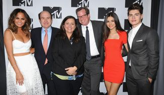 "FILE - This April 24, 2014 file photo shows, from left, Chrissy Teigen of MTV's ""Snack Off"", CEO of Viacom Philippe Dauman, President of Programming for MTV Susanne Daniels, COO of Viacom Tom Dooley, Victoria Justice of MTV's ""Eye Candy"" and Gregg Sulkin of MTV's ""Faking It"" during the 2014 MTV Upfront Presentation in New York. MTV is maturing into a more traditional television network with a broad mix of scripted and reality programming and, in Daniels, has a seasoned television executive in charge of content. (AP Photo/ MTV, Scott Gries, File)"