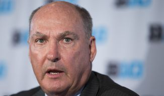Big Ten commissioner Jim Delany speaks during a news conference at Verizon Center, on Tuesday, May 6, 2014, in Washington. Delany announced that the 2017 Big Ten conference men's basketball tournament will be held in Washington. (AP Photo/ Evan Vucci)
