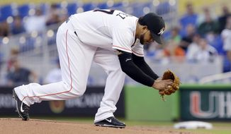 Miami Marlins' Henderson Alvarez prepares to pitch during the first inning of a baseball game against the New York Mets, Tuesday, May 6, 2014, in Miami. (AP Photo/Wilfredo Lee)