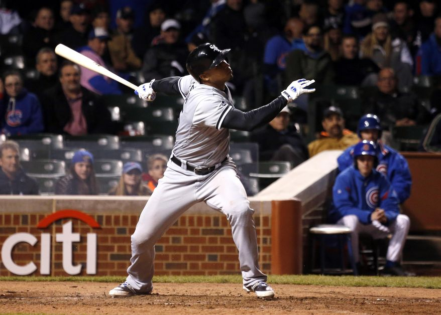 Chicago White Sox's Moises Sierra gets his fourth hit of the game off a pitch from Chicago Cubs relief pitcher Pedro Strop during the ninth inning of an interleague baseball game Tuesday, May 6, 2014, in Chicago. (AP Photo/Charles Rex Arbogast)