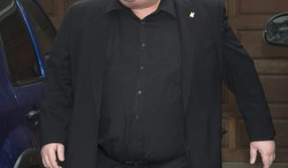 ** FILE ** In this Thursday, May 1, 2014, file photo, Toronto Mayor Rob Ford leaves his home in Toronto. The mystery of Ford's whereabouts has deepened, following reports that he did not enter the United States via Chicago last week for rehab, as expected. (AP Photo/The Canadian Press, Frank Gunn, File)