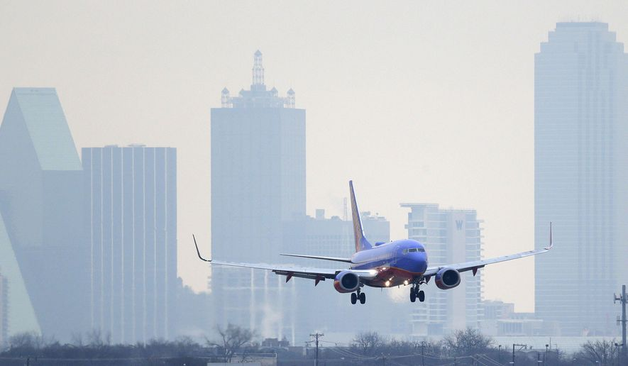 FILE - In this Feb. 3, 2014 file photo, a Southwest Airlines jet plane lines up for a landing at Love Field in Dallas. British billionaire Richard Branson on Tuesday, May 6, 2014 said that Virgin America should get gates at Love Field, near downtown Dallas, to create competition for Southwest Airlines, which controls most of the gates there. The U.S. Justice Department agrees. (AP Photo/LM Otero)