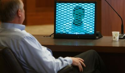 In this March 27, 2014, file photo, Lorin Holm, an exiled member of the Fundamentalist Church of Jesus Christ of Latter Day Saints, looks on as video of a deposition of FLDS Church leader Warren Jeffs is played for the court during a custody hearing between Holm and his two ex-wives who still belong to the FLDS Church in 5th District Court in St. George, Utah.  Several men exiled from Warren Jeffs' polygamous sect are warning a judge that requiring a man to pay his ex-wives' attorney fees after winning a recent custody suit would have a chilling effect on others who have been kicked out and want their children back.  (AP Photo/The Spectrum & Daily News,  Jud Burkett, Pool, File)