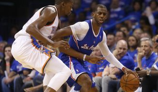 Los Angeles Clippers guard Chris Paul (3) drives against Oklahoma City Thunder forward Kevin Durant (35) in the third quarter of Game 1 of the Western Conference semifinal NBA basketball playoff series in Oklahoma City, Monday, May 5, 2014. Los Angeles won 122-105. (AP Photo/Sue Ogrocki)