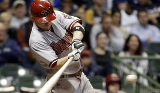 Arizona Diamondbacks' Aaron Hill hits a two-run home run during the eighth inning of a baseball game against the Milwaukee Brewers, Tuesday, May 6, 2014, in Milwaukee. (AP Photo/Morry Gash)