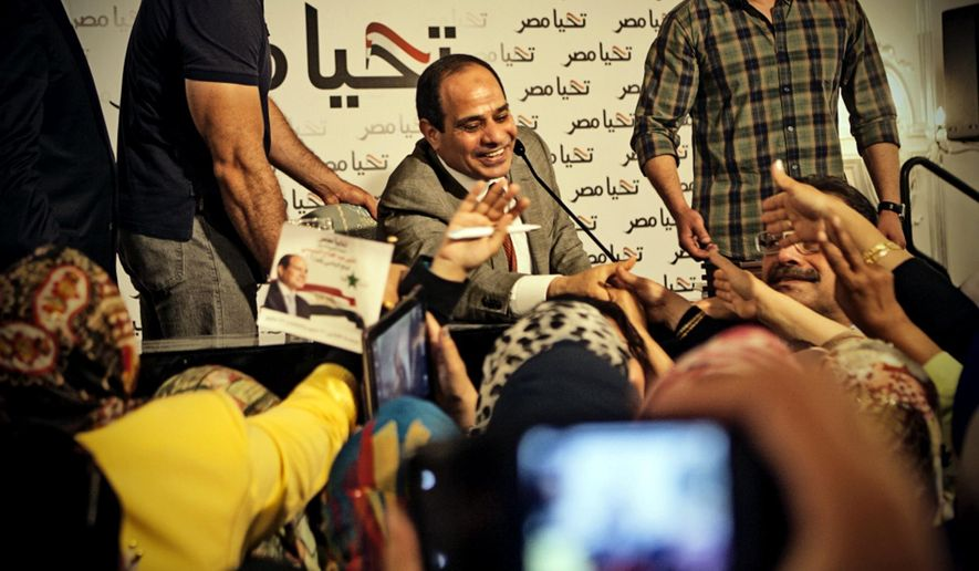 This Monday, May 5, 2014 photo released by the presidential campaign of Abdel-Fattah el-Sissi shows the candidate greeting supporters at a gathering of some 600 women in Cairo, Egypt. El-Sissi acknowledged the importance of Egyptian women in shaping the nation's history and building the nation's future according to campaign officials. (AP Photo/El-Sissi for President) **FILE**