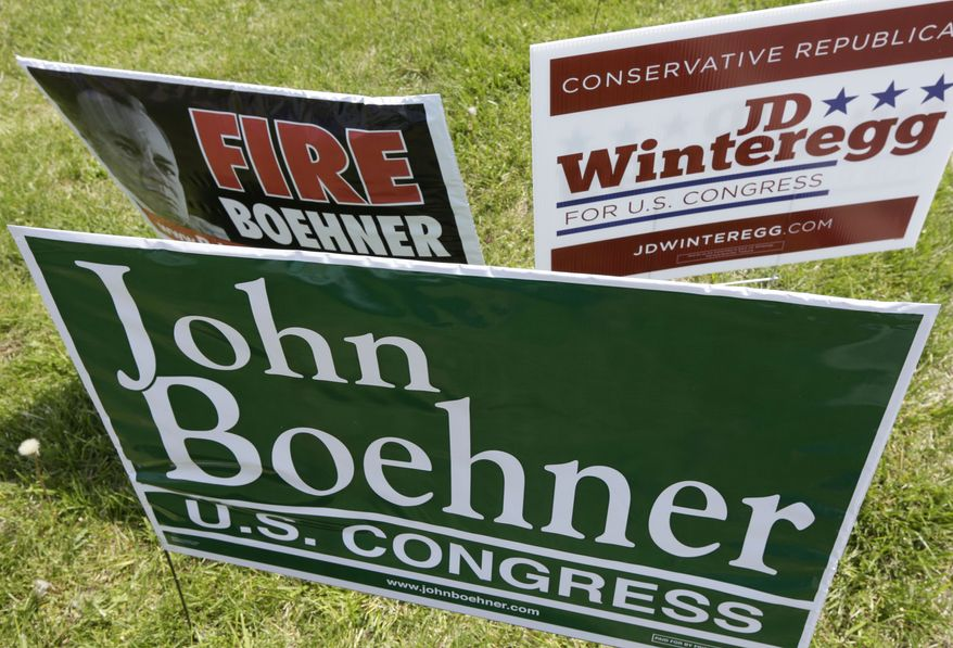 Campaign signs for Speaker John Boehner and one of his opponents, J.D. Winteregg, are posted on a road leading to a polling location, Tuesday, May 6, 2014, in West Chester, Ohio. Statewide a number of incumbent Republican lawmakers in Ohio face challengers in Tuesday's primary as they try to keep their seats this fall in the Statehouse and the U.S. Capitol. (AP Photo/Al Behrman)