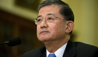 """FILE - In this Oct. 9, 2013, file photo, Veterans Affairs Secretary Eric Shinseki listens as he testifies on Capitol Hill in Washington. Senate Republican leader Mitch McConnell of Kentucky says a leadership change may help resolve what he calls """"dysfunction"""" at the Department of Veterans Affairs, following allegations of corruption and avoidable deaths at the veterans' hospital in Phoenix. McConnell says the tenure of Veterans Affairs Secretary Eric Shinseki is """"embarrassing"""" and that the agency is in """"a stunning period of dysfunction."""" McConnell isn't calling for Shinseki to step down, but says a change in leadership """"might be a good thing.""""(AP Photo/ Evan Vucci, File)"""