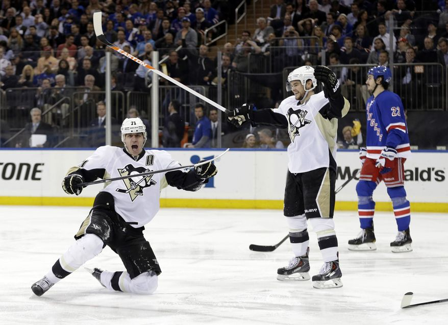 Pittsburgh Penguins' Evgeni Malkin (71), of Russia, celebrates a goal as Chris Kunitz (14) and New York Rangers' Brian Boyle (22) skate near during the first period of a second-round NHL Stanley Cup hockey playoff series Wednesday, May 7, 2014, in New York. (AP Photo/Frank Franklin II)