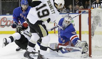 New York Rangers goalie Henrik Lundqvist (30), of Sweden, stops a shot on the goal by Pittsburgh Penguins' Beau Bennett (19) during the first period of a second-round NHL Stanley Cup hockey playoff series Wednesday, May 7, 2014, in New York. (AP Photo/Frank Franklin II)