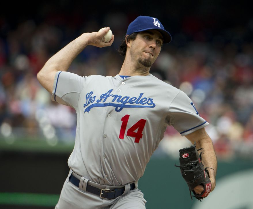 Los Angeles Dodgers starting pitcher Dan Haren (14) throws against the Washington Nationals during the first inning of a baseball game, Wednesday, May 7, 2014 in Washington. (AP Photo/Pablo Martinez Monsivais)