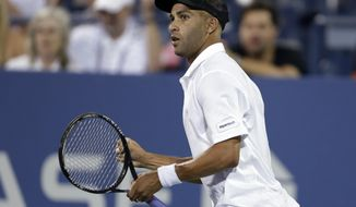 FIIn this Aug. 28, 2013 file photo, James Blake reacts during a first round match against Ivo Karlovic, of Croatia, at the U.S. Open tennis tournament in New York. (AP Photo/Darron Cummings)