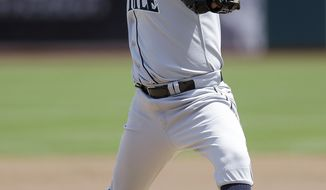 Seattle Mariners' Felix Hernandez works against the Oakland Athletics in the first inning of a baseball game Wednesday, May 7, 2014, in Oakland, Calif. (AP Photo/Ben Margot)