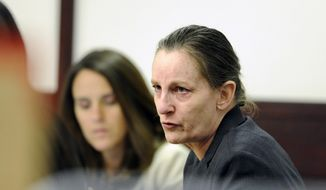 Julie Schenecker talks with attorney Jennifer Spradley on Tuesday, May 6, 2014, prior to the start of day 2 of her  trial in Tampa, Fla. Schenecker is accused of killing her two children Calyx, 16,  and Beau Schenecker, 13 in 2011. (AP Photo/The Tampa Tribune, Jay Conner, Pool)