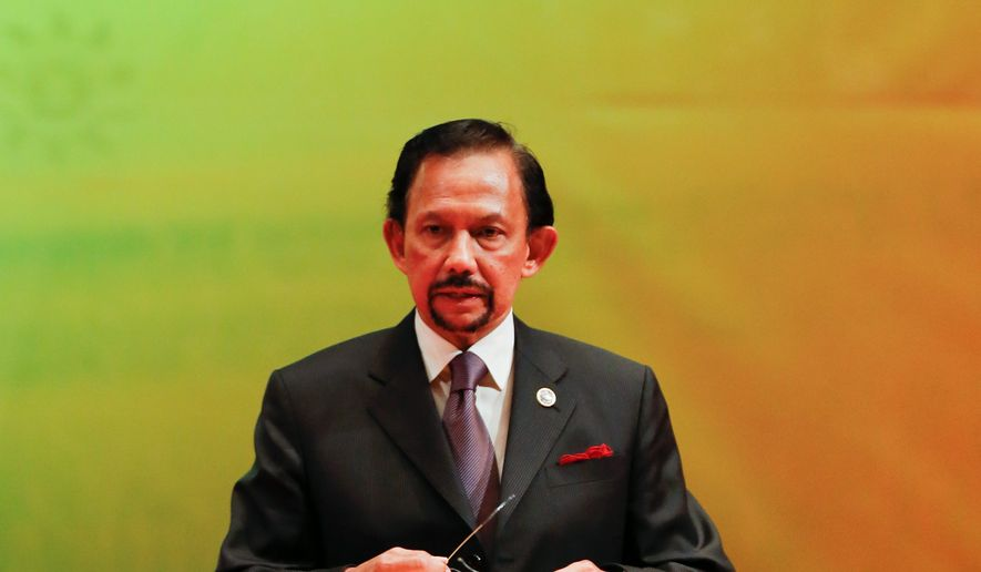 In this file photo taken Thursday, Oct. 10, 2013, Brunei's Sultan Hassanal Bolkiah speaks during the closing ceremony and handover of the ASEAN Chairmanship to Myanmar in Bandar Seri Begawan. Hollywood is responding to harsh new laws in Brunei by boycotting the Beverly Hills Hotel. The Motion Picture & Television Fund joined a growing list of organizations and individuals Monday, May 5, 2014, refusing to do business with hotels owned by the Sultan or government of Brunei to protest the country's new penal code that calls for punishing adultery, abortions and same-sex relationships with flogging and stoning. (AP Photo/Vincent Thian, file)