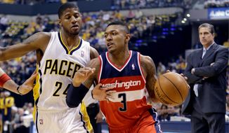After 25 points in a Game 1 victory, Bradley Beal was held to 17 Wednesday during Game 2, as Paul George (left) took over the responsibility of guarding him. (associated press)