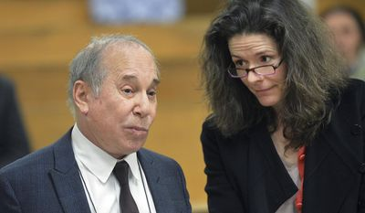 FILE - In this  Monday April 28, 2014, file photo, Singer Paul Simon, left, and his wife Edie Brickell appear at a hearing in Norwalk Superior Court in Norwalk, Conn. Paul Simon performed a rousing set and accepted an award from New York University in his first public appearance since he and wife Edie Brickell were arrested on disorderly conduct charges, on Wednesday, May 7, 2014. (AP Photo/The Hour, Alex von Kleydorff, Pool, File)