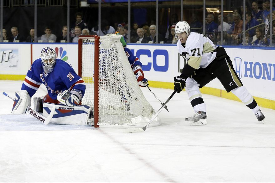 Pittsburgh Penguins' Evgeni Malkin (71), of Russia, attempts to score on New York Rangers goalie Henrik Lundqvist (30), of Sweden, during the first period of a second-round NHL Stanley Cup hockey playoff series Wednesday, May 7, 2014, in New York. (AP Photo/Frank Franklin II)