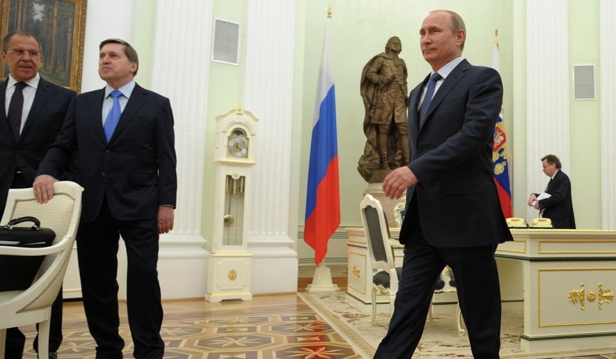 Russian President Vladimir Putin, right, heads to meet with Swiss Federal President Didier Burkhalter in the Kremlin in Moscow, Wednesday, May 7, 2014.  From left, Russian Foreign Minister Sergey Lavrov and President's aide Yury Ushakov. (AP Photo/RIA-Novosti, Alexei Druzhinin, Presidential Press Service)