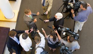 Gov. Bill Haslam speaks to reporters after an appearance at Lipscomb University in Nashville, Tenn., on Wednesday, May 7, 2014. The governor said he's concerned that an effort by some fellow Republicans to defeat three Democratic state Supreme Court Justices in August could affect a separate effort to get voters to approve a constitutional amendment on judicial selection in November. (AP Photo/Erik Schelzig)