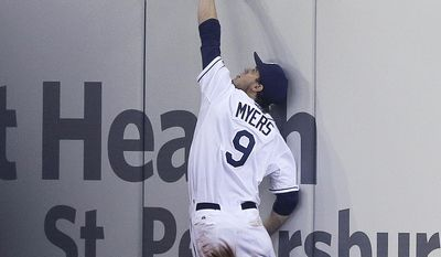 Tampa Bay Rays right fielder Wil Myers leaps but can't come up with a double by Baltimore Orioles' Steve Clevenger during the eighth inning of a baseball game Tuesday, May 6, 2014, in St. Petersburg, Fla. (AP Photo/Chris O'Meara)