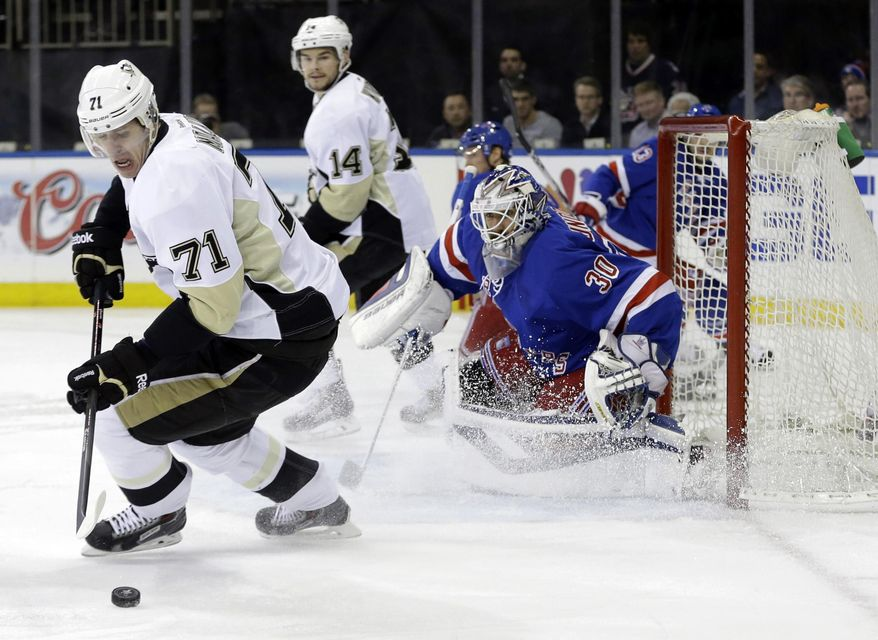 Pittsburgh Penguins' Evgeni Malkin (71) gets control of the puck in front of New York Rangers goalie Henrik Lundqvist (30), of Sweden, during the first period of a second-round NHL Stanley Cup hockey playoff series Wednesday, May 7, 2014, in New York. Malkin would score on the play. (AP Photo/Frank Franklin II)