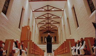"""FILE - In this July 3, 1998 file photo, Trappist monks observe their first group prayer of the day called Vigils at 3:15 a.m. in Trappist, Ky.  Within the walls of the Chapel at the Abbey of Gethsemani the monks read scripture and chant as they begin their day.   Police said John Hutchins, an accountant, began diverting money from an account at the Abbey of Gethsemani near Bardstown in 2008. Hutchins and his wife, Carrie Hutchins, were indicted by a grand jury, Wednesday, May 7, 2014,   on multiple counts of felony theft over and under $10,000 and unlawful access to a computer, said Nelson County Sheriff's Detective Jason Allison. He said they were also charged with complicity to commit theft, which """"means it was two people working together."""" (AP Photo/Tony Gutierrez)"""