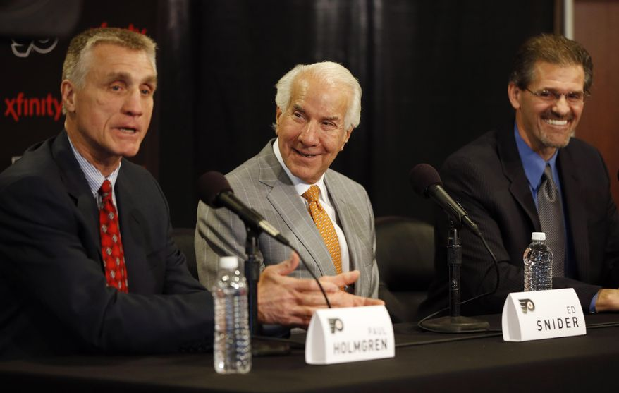 Philadelphia Flyers chairman Ed Snider, center, and new general manager Ron Hextall, right, laugh at a joke by new president Paul Holmgren during an NHL hockey news conference, Wednesday, May 7, 2014, in Philadelphia. (AP Photo/Matt Slocum)