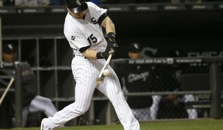 Chicago White Sox's Gordon Beckham launches a three-run home run off Chicago Cubs starting pitcher Travis Wood, also scoring Moises Sierra and Daryl Boston, during the fourth inning of an interleague baseball game Wednesday, May 7, 2014, in Chicago. (AP Photo/Charles Rex Arbogast)