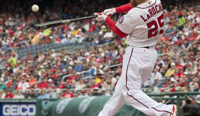 Washington Nationals Adam LaRoche connects for a two-run single against Los Angeles Dodgers starting pitcher Dan Haren during the first inning of a baseball game, Wednesday, May 7, 2014 in Washington. (AP Photo/Pablo Martinez Monsivais)