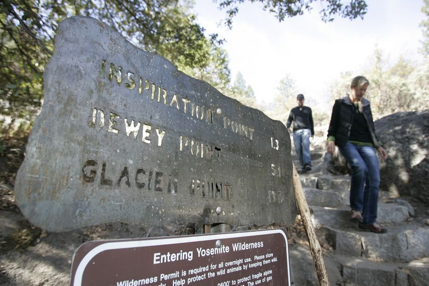 **FILE** Hikers walk on new steps at a viewing area at Yosemite National Park in California on Oct. 20, 2008. (Associated Press)