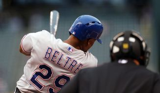 Texas Rangers' Adrian Beltre follows through with his swing after connecting for a solo home run against the Colorado Rockies in the first inning of an interleague baseball game in Denver on Tuesday, May 6, 2014. (AP Photo/David Zalubowski)