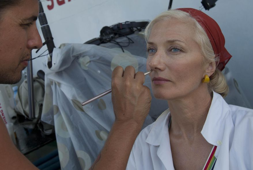 """In this April 24, 2014 photo, actor Joely Richardson sits down to have her makeup applied during the shooting of the movie """"Papa"""" in Havana Bay, Cuba. An international film crew has been re-enacting this and other historic scenes from the 1950s in the streets of Havana in recent weeks for """"Papa,"""" a biopic about the budding friendship between Hemingway and a young journalist in turbulent, pre-revolution Cuba. (AP Photo/Yesica Fish)"""
