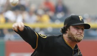 Pittsburgh Pirates' Gerrit Cole (45) throws against the San Francisco Giants in the first inning of a baseball game on Wednesday, May 7, 2014, in Pittsburgh.  (AP Photo/Keith Srakocic)