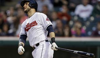 Cleveland Indians' Yan Gomes watches his solo home run off Minnesota Twins starting pitcher Ricky Nolasco in the fifth inning of a baseball game Wednesday, May 7, 2014, in Cleveland. (AP Photo/Mark Duncan)
