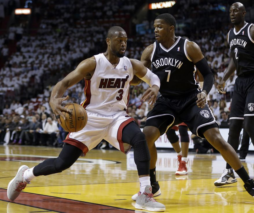 Miami Heat's Dwyane Wade (3) drives to the basket as Brooklyn Nets guard Joe Johnson (7) defends in the first half of Game 1 in an NBA Eastern Conference semifinal basketball series, Tuesday, May 6, 2014, in Miami. (AP Photo/Lynne Sladky)
