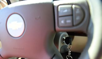 This April 1, 2014, file photo shows a key in the ignition switch of a 2005 Chevrolet Cobalt in Alexandria, Va. (AP Photo/Molly Riley, File)
