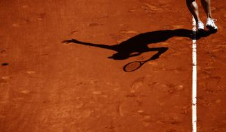 Na Li from China serves the ball during a Madrid Open tennis tournament match against Sloane Stephens from U.S. in Madrid, Spain, Thursday, May 8, 2014 . (AP Photo/Daniel Ochoa de Olza)