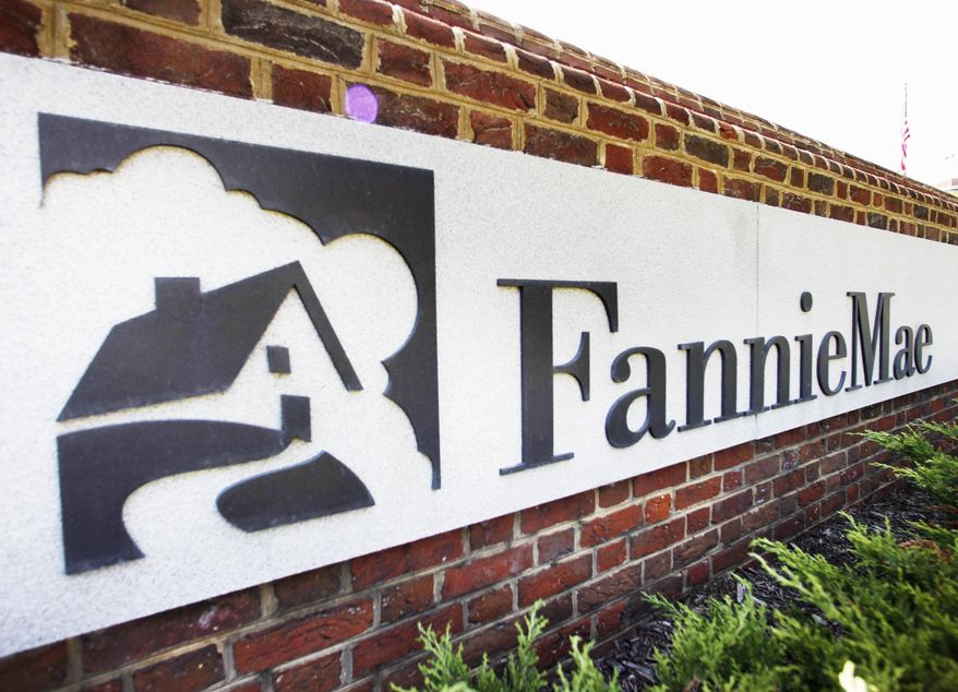 FILE - This Monday, Aug. 8, 2011 file photo shows the Fannie Mae headquarters in Washington. Fannie Mae reports quarterly results for the January-March 2014 quarter on Thursday, May 8, 2014. (AP Photo/Manuel Balce Ceneta, File)