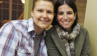 FILE - In this 2011 file photo, Amy Sandler, right, and her wife, Niki Quasney, pose for a photo in Munster, Ind. U.S. District Judge Richard Young's injunction Thursday, May 8, 2014, extends an April 10 temporary restraining order requiring the state to list Sandler as Quasney's spouse after Quasney dies of cancer. It applies only to them, not to other gay couples who were legally wed elsewhere and are also seeking to have Indiana recognize their marriages. (AP Photo/Sun-Times Media, Jeffrey D. Nicholls)