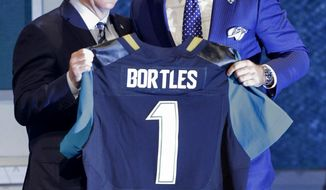 Central Florida quarterback Blake Bortles poses with NFL commissioner Roger Gooddell after being selected as the third pick by the Jacksonville Jaguars in the first round of the 2014 NFL Draft, Thursday, May 8, 2014, in New York. (AP Photo/Frank Franklin II)