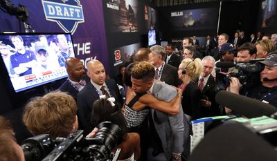 Odell Beckham, Jr., from LSU, is congratulated after being selected 12th overall by the New York Giants in the first round of the NFL football draft, Thursday, May 8, 2014, at Radio City Music Hall in New York. (AP Photo/Jason DeCrow)