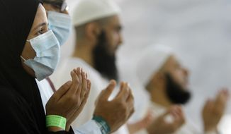 Egyptian Muslim pilgrims pray last year after they cast stones at a pillar, symbolizing the stoning of Satan, in a ritual called Jamarat; the last rite of the annual hajj, in Mina near the Muslim holy city of Mecca, Saudi Arabia. (AP Photo/Amr Nabil, File)
