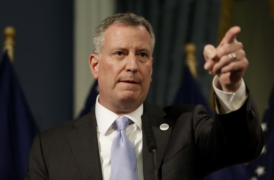 ** FILE ** New York City Mayor Bill de Blasio presents the 2015 city budget at City Hall in New York, Thursday, May 8, 2014. (AP Photo/Seth Wenig, Pool)