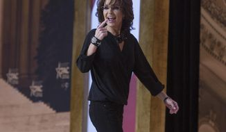 File - In this March 8, 2014 file photo, former Alaska Gov. and 2008 Republican vice presidential nominee Sarah Palin gestures to the crowd as she walks off-stage after addressing the Conservative Political Action Committee annual conference in National Harbor, Md.  Palin defended as fair and commonsense the oil tax structure she championed while in office, a system that has been dismantled by state lawmakers and her successor, fellow Republican Sean Parnell. Palin also took a swipe at Parnell on Anchorage radio station KWHL Wednesday, May 7, 2014, when asked about Parnell's change in direction. (AP Photo/Cliff Owen, File)