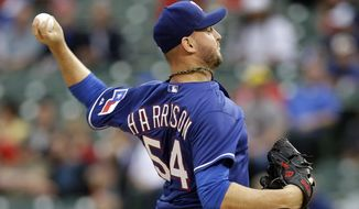 Texas Rangers starting pitcher Matt Harrison (54) works against the Colorado Rockies in the second inning of a baseball game, Thursday, May 8, 2014, in Arlington, Texas. (AP Photo/Tony Gutierrez)