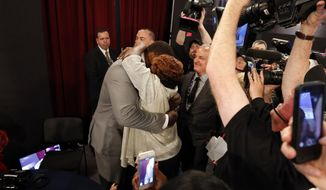 Greg Robinson, from Auburn, reacts after being selected second overall in the first round of the NFL football draft by the St. Louis Rams, Thursday, May 8, 2014, at Radio City Music Hall in New York. (AP Photo/Jason DeCrow)