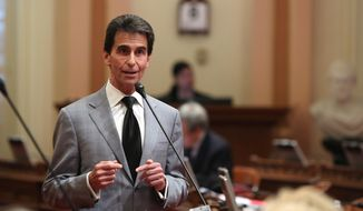 State Sen. Mark Leno, D-San Francisco, urges lawmakers to approve his measure requiring electronics manufacturers to install a shut-off function in all smartphones manufactured and sold after July 2015,  at the Capitol  in Sacramento, Calif., Thursday May 8, 2014.  The bill, SB962, which fell two votes short of passage when it was brought up two weeks ago, was approved by the Senate by a 26-8 vote. (AP Photo/Rich Pedroncelli)