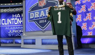 Alabama free safety Haha Clinton-Dix poses for photos after being selected by the Green Bay Packers as the 21st pick in the first round of the 2014 NFL Draft, Thursday, May 8, 2014, in New York. (AP Photo/Craig Ruttle)