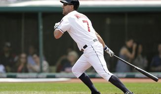 Cleveland Indians' David Murphy watches his ball after hitting an RBI-double off Minnesota Twins starting pitcher Kevin Correia in the first inning of a baseball game, Thursday, May 8, 2014, in Cleveland. Michael Brantley scored (AP Photo/Tony Dejak)